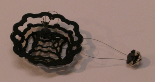 'Planar radial pattern 2' ; blackened mild steel, steel cable, sterling silver